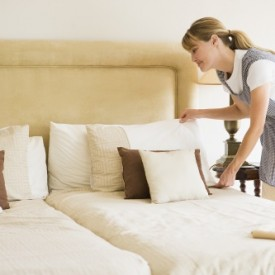 bigstock_Maid_Making_Bed_In_Hotel_Room__4136203LR